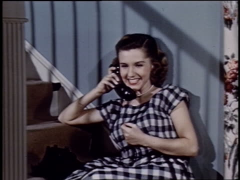 1952 young woman sitting on stairs talking on telephone - landline phone stock videos & royalty-free footage