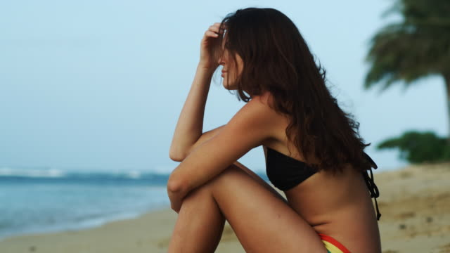 young woman sitting on the beach - fan palm tree stock videos & royalty-free footage