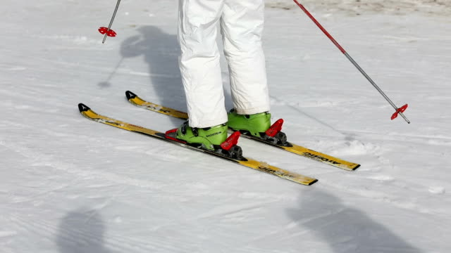 Young woman skiing on ski slope