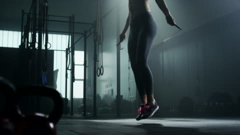 young woman skipping rope - gym stock videos & royalty-free footage