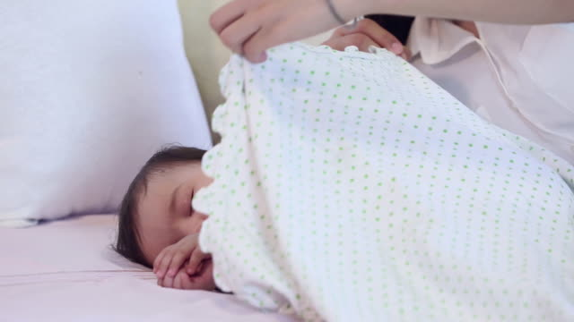young woman sleeping her son in the home - baby blanket stock videos & royalty-free footage