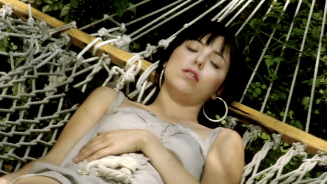 ms young woman sleeping in hammock/ los angeles, california - hoop earring stock videos and b-roll footage