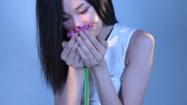 CU Young woman smelling calla lily flowers / New York, New York, USA