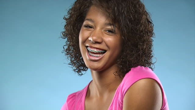 young woman smiling at camera - see other clips from this shoot 1164 stock videos & royalty-free footage