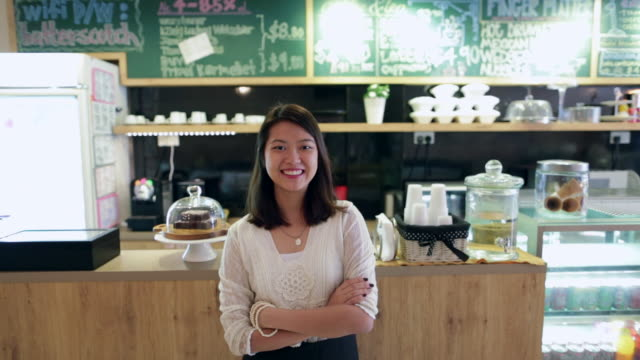ws young woman smiling in a cafe. - western script stock videos & royalty-free footage