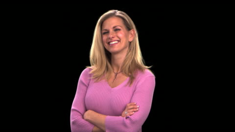 vídeos y material grabado en eventos de stock de young woman smiling - this clip has an embedded alpha-channel - keyable