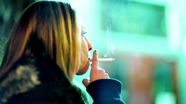young woman smoking - cigarette stock videos & royalty-free footage