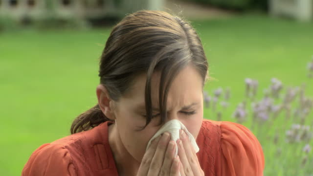 young woman sneezing - hay fever stock videos & royalty-free footage