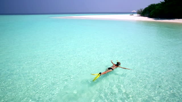 young woman snorkelling in maldives, indian ocean - indian ocean stock videos & royalty-free footage