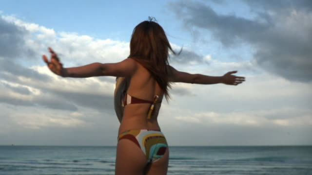 ms slo mo young woman spinning around on beach / south beach, florida, usa - miami beach stock videos & royalty-free footage