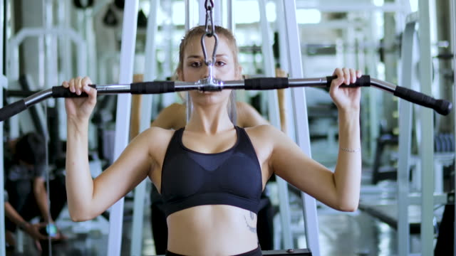 young woman sporty doing exercise in fitness gym. - treadmill stock videos & royalty-free footage