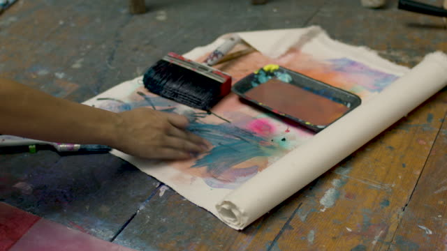 young woman squeezing paint tube - paint tube stock videos and b-roll footage