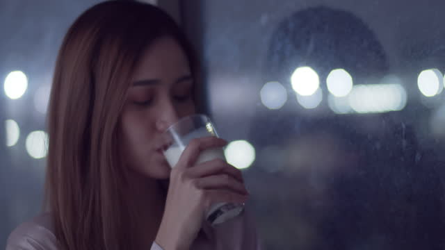 young woman standing and drinking milk - refreshment stock videos & royalty-free footage