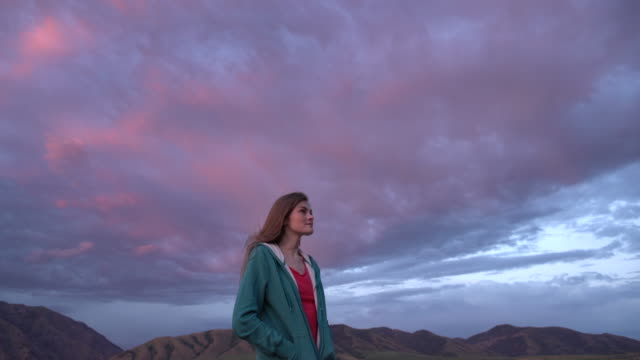 ms young woman standing and relaxing on mountain - single cloud sky stock videos & royalty-free footage