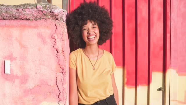 young woman standing at a door and smiling - 20 24 years stock videos & royalty-free footage