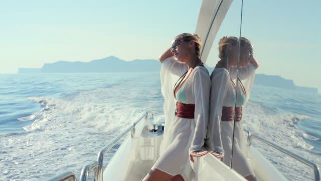 ms young woman standing at rear of luxury yacht / portals nous, mallorca, spain - glamour stock videos & royalty-free footage