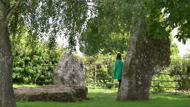 a young woman standing near the cove a neolithic stone monument next to stanton drew stone circle - obelisk stock videos & royalty-free footage