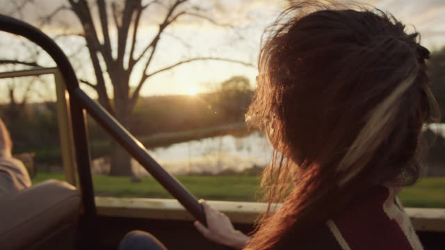 young woman stares out at scenic landscape from backseat of classic bronco - 4x4 stock videos & royalty-free footage