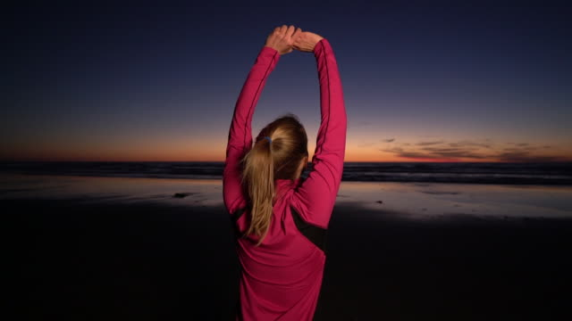 MS SM Young woman stretching at twilight