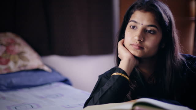 Young woman studying and thinking.