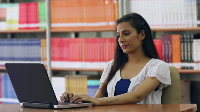 Young woman studying on a laptop, Noida, Uttar Pradesh, India
