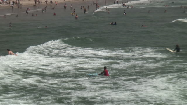 (HD1080i) Young Woman Surfing, Riding Wave to Shore / Beach