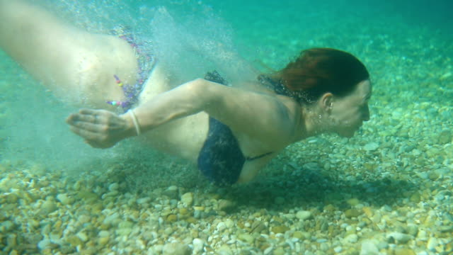 young woman swim underwater - below stock videos and b-roll footage