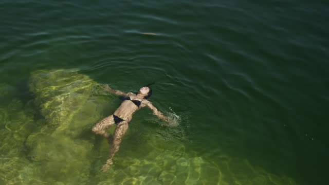 ws ha young woman swimming in lake powell / utah, usa - lake powell stock videos and b-roll footage
