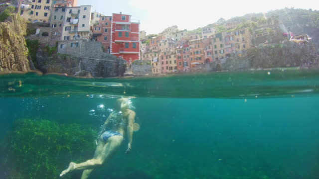 ms young woman swimming underwater in sea, cinque terre, italy - swimwear stock videos & royalty-free footage