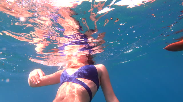 young woman swims in clear sea, above anchor - buoy stock videos & royalty-free footage