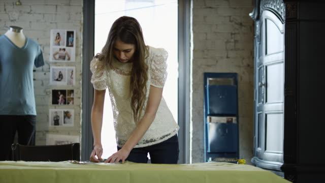 MS Young woman tailoring textile in workshop / Salt Lake City,Utah,USA
