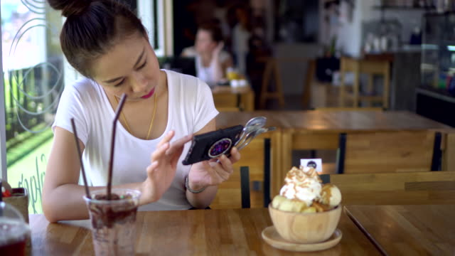 young woman take a photo of ice-cream with mobile phone - food photography stock videos & royalty-free footage