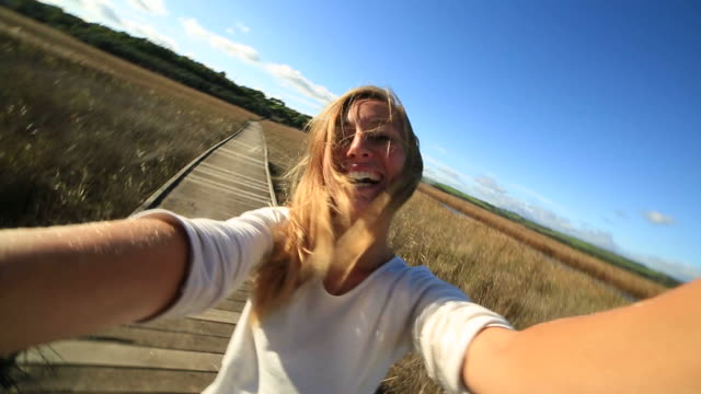 young woman takes a selfie portrait in nature - elevated walkway stock videos & royalty-free footage