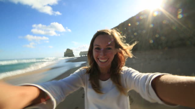 Young woman takes a selfie portrait on Gibsons steps beach