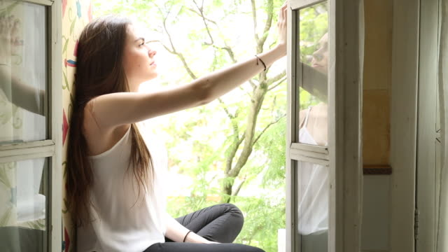 young woman takes pic from villa windowsill - ecuadorian ethnicity stock videos & royalty-free footage