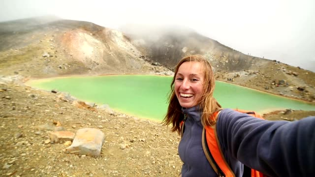 young woman takes selfie portrait at the emerald lakes, tongariro - tongariro national park stock videos & royalty-free footage