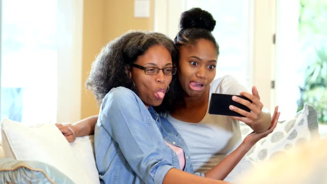 young woman takes selfie with her beautiful mature mother - adult student stock videos & royalty-free footage