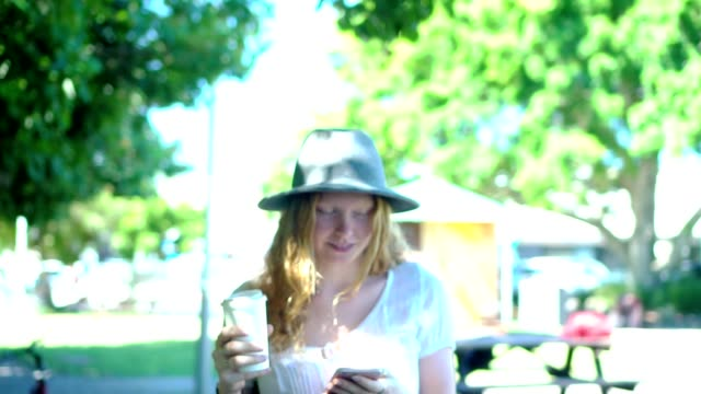 young woman taking a break and drink coffee in the park - coffee drink stock videos & royalty-free footage