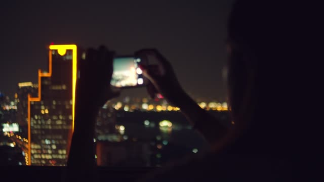 cu young woman taking and sending a photo of cityscape at bangkok, - photo messaging stock videos & royalty-free footage