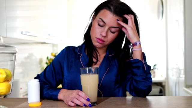 young woman taking aspirin for a headache - aspirin stock videos & royalty-free footage