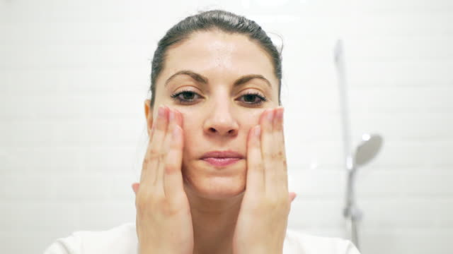 young woman taking care of her skin. - scrubbing stock videos & royalty-free footage