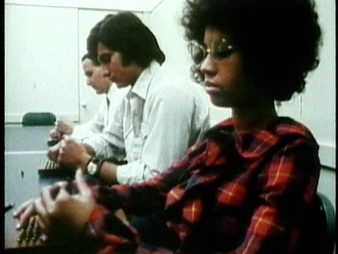 1971 montage ms cu young woman taking employment aptitude tests in office / usa / audio - antworten stock-videos und b-roll-filmmaterial