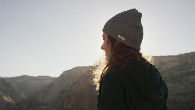 young woman taking in the view at top of a cliff - canyon stock videos & royalty-free footage