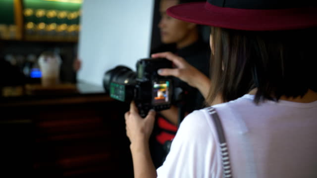 young woman taking photo with slr camera - slr camera stock videos and b-roll footage