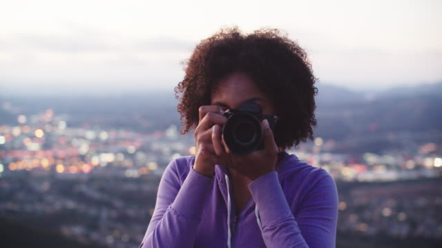 young woman taking photos with a camera - photography stock videos & royalty-free footage