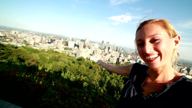 young woman taking selfie in montreal - montreal stock videos and b-roll footage