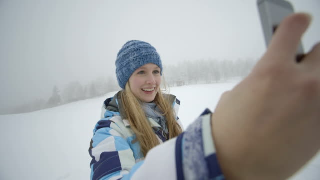 young woman taking selfie in snow - ski jacket stock videos & royalty-free footage