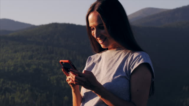 young woman taking selfie on mobile phone while enjoying her vacation - one young woman only stock videos & royalty-free footage
