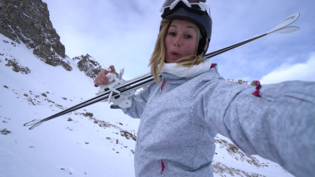 young woman taking selfie on ski slopes - goggles sportswear stock videos and b-roll footage