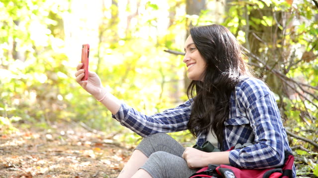 Young woman taking selfie with her mobile phone